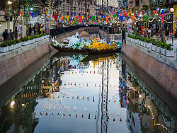 November 19, 2018 - Bangkok, Bangkok, Thailand - Decorative boats in the canal at the Loy Krathong Fair along Klong (Canal) Ong Ang in Bangkok. This the first public event along the canal. Businesses that line the canal weve evicted about two years and the walkways along the canal were renovated. Loy Krathong takes place on the evening of the full moon of the 12th month in the traditional Thai lunar calendar. In the western calendar this usually falls in November. Loy means 'to float', while krathong refers to the usually lotus-shaped container which floats on the water. Traditional krathongs are made of the layers of the trunk of a banana tree or a spider lily plant. Now, many people use krathongs of baked bread which disintegrate in the water and feed the fish. A krathong is decorated with elaborately folded banana leaves, incense sticks, and a candle. A small coin is sometimes included as an offering to the river spirits. On the night of the full moon, Thais launch their krathong on a river, canal or a pond, making a wish as they do so. The krathongs made at the Klong Ong Ang fair were made out of bread so they would decompose and feed the fish in the canal. Loy Krathong will be celebrated on November 22 this year. (Credit Image: © Sean Edison/ZUMA Wire)