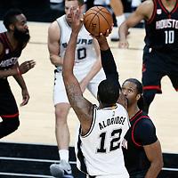 03 May 2017: San Antonio Spurs forward LaMarcus Aldridge (12) takes a jump shot over Houston Rockets center Nene Hilario (42) during the San Antonio Spurs 121-96 victory over the Houston Rockets, in game 2 of the Western Conference Semi Finals, at the AT&T Center, San Antonio, Texas, USA.