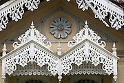 Sri Lanka. Intricate wood detailing on windows of an old house in the town of Seenigama, near Galle. The structures over the windows are used to keep driving rain out.<br /> Licensed to Lynear Wealth Management on July 2016 for two years.