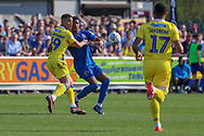 AFC Wimbledon defender Paul Kalambayi (30) battles for possession with Bristol Rovers attacker Jonson Clarke-Harris (19) during the EFL Sky Bet League 1 match between AFC Wimbledon and Bristol Rovers at the Cherry Red Records Stadium, Kingston, England on 19 April 2019.