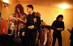 The post-punk band The Killers perform at the Hammerstein Ballroom at Manhattan Center Studios in New York, N.Y. on Oct. 24, 2008. Guitarist Dave Keuning and singer Brandon Flowers discuss the set list, while drummer Ronnie Vannucci Jr. checks his phone backstage.