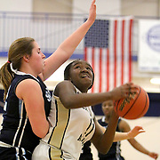 Cape Fear Academy's Nnemka Agbafe looks to shoot around South Brunswick's Kayla Frye on the first day of the Cape Fear Academy Holiday Basketball Tournament. (Jason A. Frizzelle)
