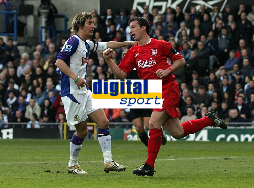 Photo: Paul Thomas.<br /> Blackburn Rovers v Liverpool. The Barclays Premiership. 16/04/2006.<br /> <br /> Liverpool's Robbie Fowler celebrates his goal while Blackburn's Morten Gamst Pederson claims he was offside.