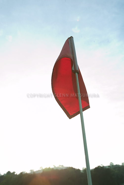 Golf hole flag at Stanford golf course.