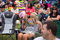 © Licensed to London News Pictures . 09/08/2015 . Siddington , UK . The crowd . The Rewind Festival of 1980s music , fashion and culture at Capesthorne Hall in Macclesfield . Photo credit: Joel Goodman/LNP