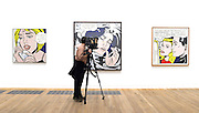 "© Licensed to London News Pictures. 18/02/2013. London, UK A camera man stand in front of ""Drowning Girl""  1963. Press view for Tate Modern's ""Lichtenstein: A Retrospective"". It is the first major Lichtenstein retrospective for twenty years, bringing together 125 of the artists most definitive paintings. The exhibition is open to the public from 21 February -  27 May 2013.  Photo credit : Stephen Simpson/LNP"