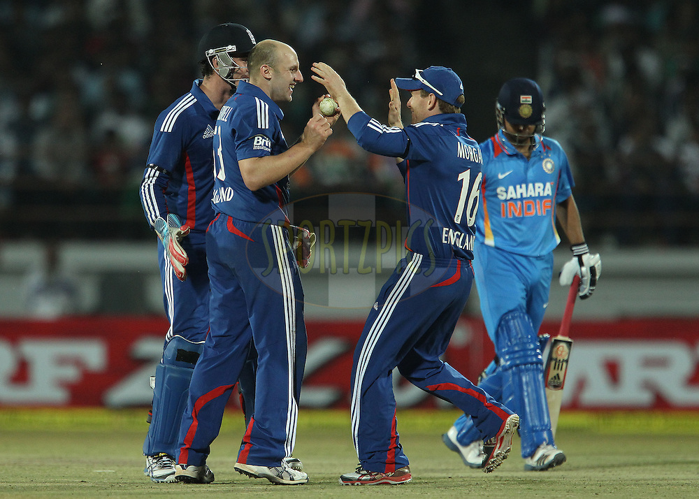 James Tredwell of England celebrates the wicket of Suresh Raina of India during the 1st Airtel ODI Match between India and England held at the SAURASHTRA CRICKET ASSOCIATION STADIUM, RAJKOT, India on the 11th January 2013..Photo by Ron Gaunt/BCCI/SPORTZPICS ..Use of this image is subject to the terms and conditions as outlined by the BCCI. These terms can be found by following this link:..http://www.sportzpics.co.za/image/I0000SoRagM2cIEc