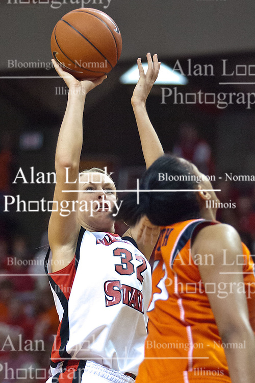 28 March 2010: Maggie Krick lifts a shot over Jenna Smith. The Redbirds of Illinois State squeak past the Illini of Illinois 53-51 in the 4th round of the 2010 Women's National Invitational Tournament (WNIT) on Doug Collins Court inside Redbird Arena at Normal Illinois.