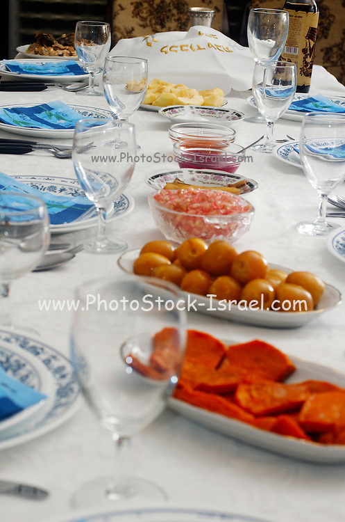 Table set for the Jewish feast of Rosh Hashana, the start of the new Jewish year, with traditional symbolic dishes and foods, Dates, pomegranate, Honey, Apple and wine