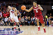 DALLAS, TX - NOVEMBER 25: Anthlon Bell #5 of the Arkansas Razorbacks brings the ball up court against the SMU Mustangs on November 25, 2014 at Moody Coliseum in Dallas, Texas.  (Photo by Cooper Neill/Getty Images) *** Local Caption *** Anthlon Bell