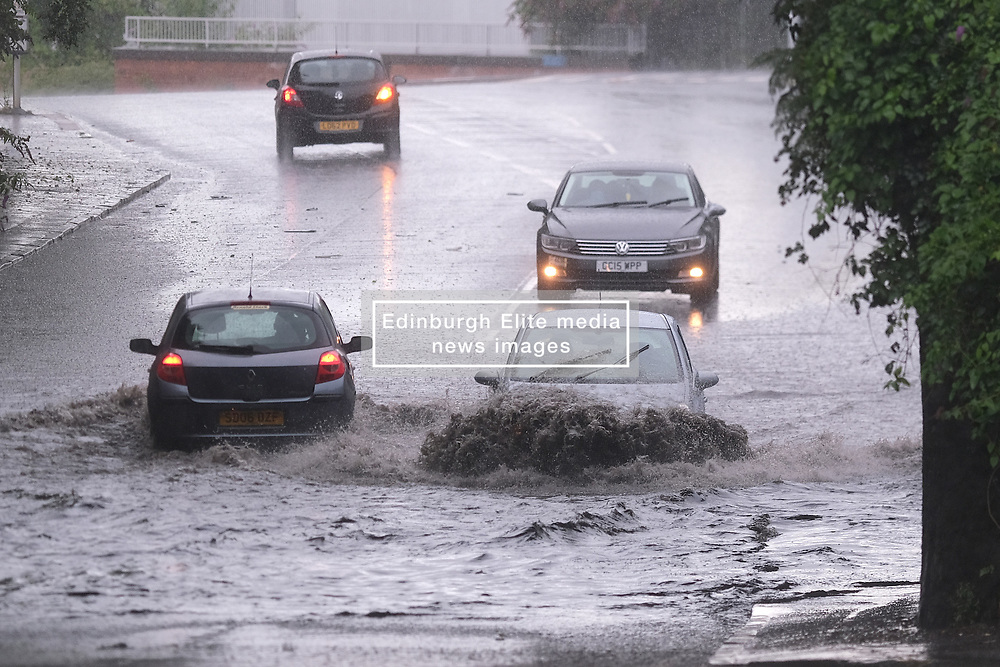 Thunderstorm in Glasgow, 07 August 2021<br /> <br /> Thunderstorms in Glasgow caused flash flooding in Possil Road.<br /> <br /> It caught out pedestrians, cyclists and drivers, some of whom turned back but most took the chance to drive through.<br /> <br /> Alex Todd   Edinburgh Elite Media