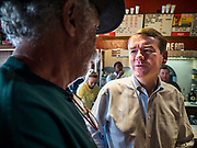 27 JULY 2019 - INDIANOLA, IOWA: US Senator MICHAEL BENNET (D-CO) talks to a man after a voter meet and greet event at a cafe in Indianola Saturday. Sen. Bennet is running for the Democratic nomination for the US Presidency in the 2020 election. Iowa traditionally hosts the the first election event of the presidential election cycle. The Iowa Caucuses will be on Feb. 3, 2020.          PHOTO BY JACK KURTZ