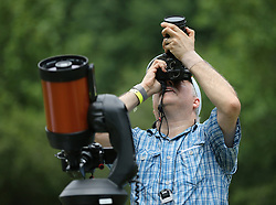 Joey Trota, Atlanta, photographs the total solar eclipse and records a video with his Celestron telescope during a solar eclipse shabbat at Ramah Darom on Monday, August 21, 2017, in Clayton, a city in the path of totality in North Georgia. Photo by Curtis Compton/Atlanta Journal-Constitution/TNS/ABACAPRESS.COM