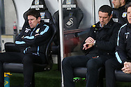 Remi Garde (r) the Aston Villa manager looks at his watch. Barclays Premier league match, Swansea city v Aston Villa at the Liberty Stadium in Swansea, South Wales on Saturday 19th March 2016.<br /> pic by  Andrew Orchard, Andrew Orchard sports photography.
