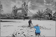 SERIES - DAY-TRIPPER by Paul Williams - Day Tripper - London Tower Bridge is a selective colour street photography series by photographer Paul Williams  of tourists making a snowman and posing for photos, London taken in 2008 . .<br /> <br /> Visit our REPORTAGE & STREET PEOPLE PHOTO ART PRINT COLLECTIONS for more wall art photos to browse https://funkystock.photoshelter.com/gallery-collection/People-Photo-art-Prints-by-Photographer-Paul-Williams/C0000g1LA1LacMD8