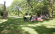 People having picnic in Botanical gardens at Bath, north east Somerset, England, UK