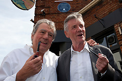 © under license to London News Pictures. 25/06/12..Fellow Pythons Terry Jones and Michael Palin(left-right) outside The Angel Inn at the unveiling of a blue plaque to former Monty Python star, Graham Chapman. The memorial has been organised by Chapman's family, friends, and former colleagues, following the news that English Heritage have dropped plans for an 'official' Blue Plaque to the star, due to budget cuts. ..ALEX CHRISTOFIDES/LNP