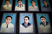 Old portraits inside a temple in Hoi An, Vietnam.