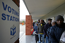 Wednesday 8th May 2019.<br /> Sinenjongo High School, Joe Slovo Park,<br /> Milnerton, Cape Town, <br /> Western Cape, <br /> South Africa.<br /> <br /> SOUTH AFRICAN GENERAL ELECTIONS 2019!<br /> <br /> SOUTH AFRICAN PROVINCIAL AND NATIONAL ELECTIONS 2019! <br /> <br /> A voting station sign is seen on a busy but cold and rainy day as voters wait their turn to cast their vote at Sinenjongo High School, Joe Slovo Park near Milnerton, Cape Town, Western Cape, South Africa. <br /> <br /> Registered South African Voters head to the various IEC (Independent Electoral Commission) Voting Stations where they are registered to vote as they cast their votes and take part in voting and other activities on Voting Day 8th May 2019 during the South African General Elections 2019. Voters from across the nation stood in queue's along with many others to vote in the Provincial and National Elections being held in South Africa on Wednesday 8th May 2019.   <br />  <br /> Copyright © Mark Wessels. All Rights Reserved. No Usage Without Permission.<br /> <br /> PICTURE: MARK WESSELS. 08/05/2019.<br /> +27 (0)61 547 2729.<br /> mark@sevenbang.com<br /> studioseven@mweb.co.za<br /> www.markwesselsphoto.com