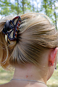 adult woman with hair put up with a hair clip