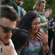 CHARLOTTE NC - MAY 1: A student gets emotional as she comes to the steps of  Kennedy Hall to lay a candle to honor the victims of a shooting the day earlier on the University of North Carolina Charlotte campus in University City, Charlotte, NC on April 30, 2019.  (Logan Cyrus for AFP)