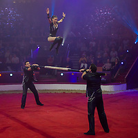 Members of the Trio Stoian of Romania perform their Silver Pierrot Award winning act with the Russian bar during the 10th International Circus Festival in Budapest, Hungary on January 13, 2014. ATTILA VOLGYI