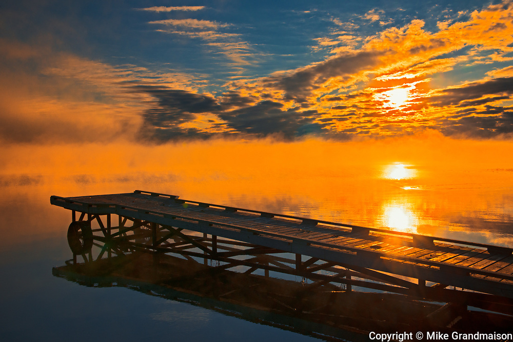Dock in fog at sunrise on Sturgeon Lake<br />Williamson Provincial Park<br />Alberta<br />Canada