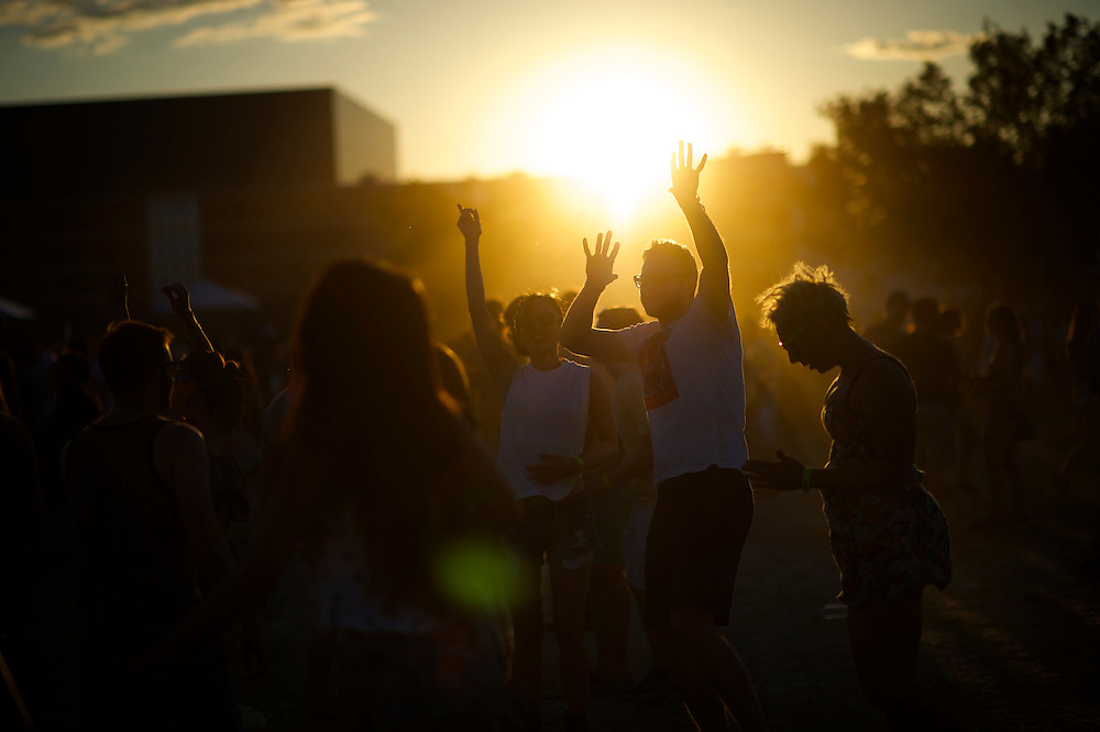 Revelers dance as the sun sets during the Governors Ball Music Festival on Randall's Island in New York, NY on June 7, 2014.