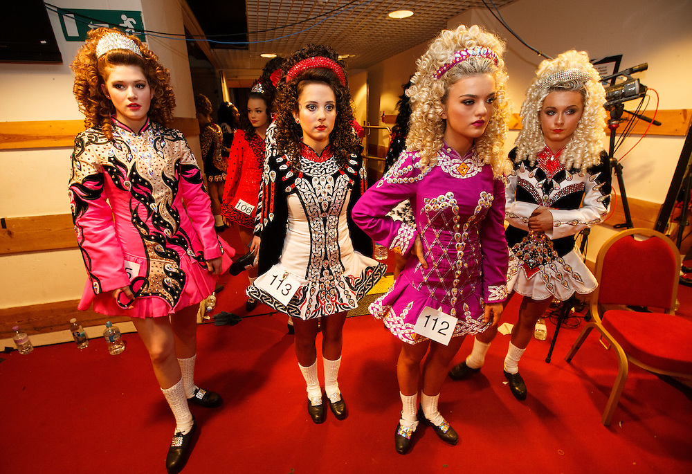 """Belgian Irish Dancer Alicia Bellemans, left(16) prepares to enter the stage. She got to Glasgow for The 46th annual World Irish Dancing Championships at the Glasgow Royal Concert Hall from March 20th- 27th 2016. From Brussels she is the first Belgian to have qualified for the Championships and were not letting the terrorist  attack and airport closures and transport problems beat them to fulfil their passion to compete at Irish Dancing. Alicia said """" We have to do what we love. We won't stop, they won't stop our passion for Irish dancing, we are afraid, but we fight"""". Alicia had to be in Glasgow for her dance slot at 12.30. She has been on the move since 2am and finally got here via Amsterdam.  Picture Robert Perry 23rd March 2016<br /> <br /> Must credit photo to Robert Perry<br /> FEE PAYABLE FOR REPRO USE<br /> FEE PAYABLE FOR ALL INTERNET USE<br /> www.robertperry.co.uk<br /> NB -This image is not to be distributed without the prior consent of the copyright holder.<br /> in using this image you agree to abide by terms and conditions as stated in this caption.<br /> All monies payable to Robert Perry<br /> <br /> (PLEASE DO NOT REMOVE THIS CAPTION)<br /> This image is intended for Editorial use (e.g. news). Any commercial or promotional use requires additional clearance. <br /> Copyright 2014 All rights protected.<br /> first use only<br /> contact details<br /> Robert Perry     <br /> 07702 631 477<br /> robertperryphotos@gmail.com<br /> no internet usage without prior consent.         <br /> Robert Perry reserves the right to pursue unauthorised use of this image . If you violate my intellectual property you may be liable for  damages, loss of income, and profits you derive from the use of this image."""