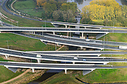 Nederland, Noord-Brabant, Eindhoven, 24-10-2013; Randweg Eindhoven, Knooppunt De Hogt, A2 en A 67. Riviertje de Dommel maakt deel uit van de landschappelijke inpassing.<br /> Ringroad Eindhoven with motorway junction. The spacial design includes the local river.<br /> luchtfoto (toeslag op standaard tarieven);<br /> aerial photo (additional fee required);<br /> copyright foto/photo Siebe Swart.
