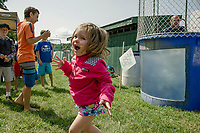 "Lucia was excited the ""dunk"" Michael Giovanitto in the Cal Ripken dunking booth during Old Home Day festivities on Saturday afternoon.  (Karen Bobotas/for the Laconia Daily Sun)"