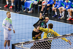 Marcel Schiller of Germany vs Urban Lesjak of Slovenia during handball match between National Teams of Germany and Slovenia at Day 2 of IHF Men's Tokyo Olympic  Qualification tournament, on March 13, 2021 in Max-Schmeling-Halle, Berlin, Germany. Photo by Vid Ponikvar / Sportida