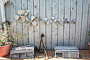 Anchor, propellers and lobster traps decorate a wall along the King's Highway in Alice Town on the tiny Caribbean island of Bimini, Bahamas.
