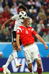 June 19, 2018 - Saint Petersburg, Russia - Marwan Mohsen (L) of the Egypt national football team and Iury Gazinsky of the Russia national football team vie for the ball during the 2018 FIFA World Cup match, first stage - Group A between Russia and Egypt at Saint Petersburg Stadium on June 19, 2018 in St. Petersburg, Russia. (Credit Image: © Igor Russak/NurPhoto via ZUMA Press)