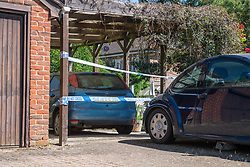 © Licensed to London News Pictures. 21/05/2020. Beaconsfield, UK. Police tape marks a cordon around a backyard of a property on North Drive. Thames Valley Police were called to North Drive, Beaconsfield at around 00:01 BST on Thursday 21/05/2020 to a report of a stabbing. A man in his forties had sustained injuries consistent with stab wounds and was taken to hospital. Photo credit: Peter Manning/LNP