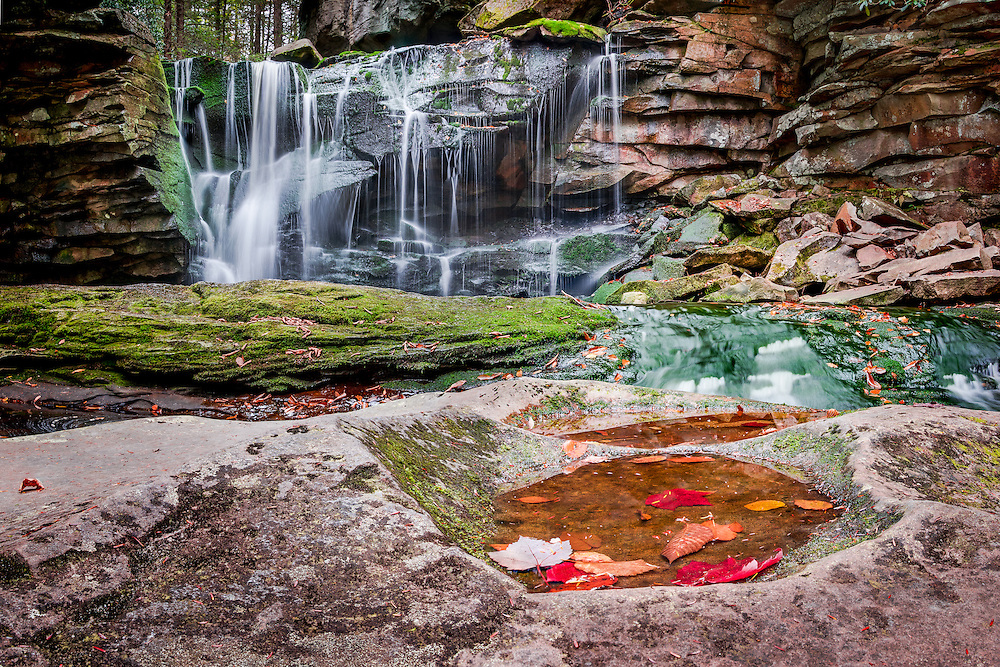 Low angle view showing the changing leaves of autumn and the first set on falls on Shay's Run near Blackwater Falls, West Virginia.