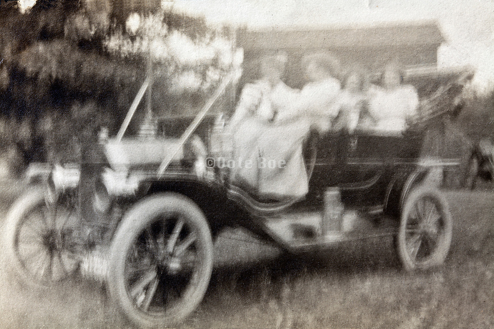 vintage image of women sitting in a car taken with a strong camera shake