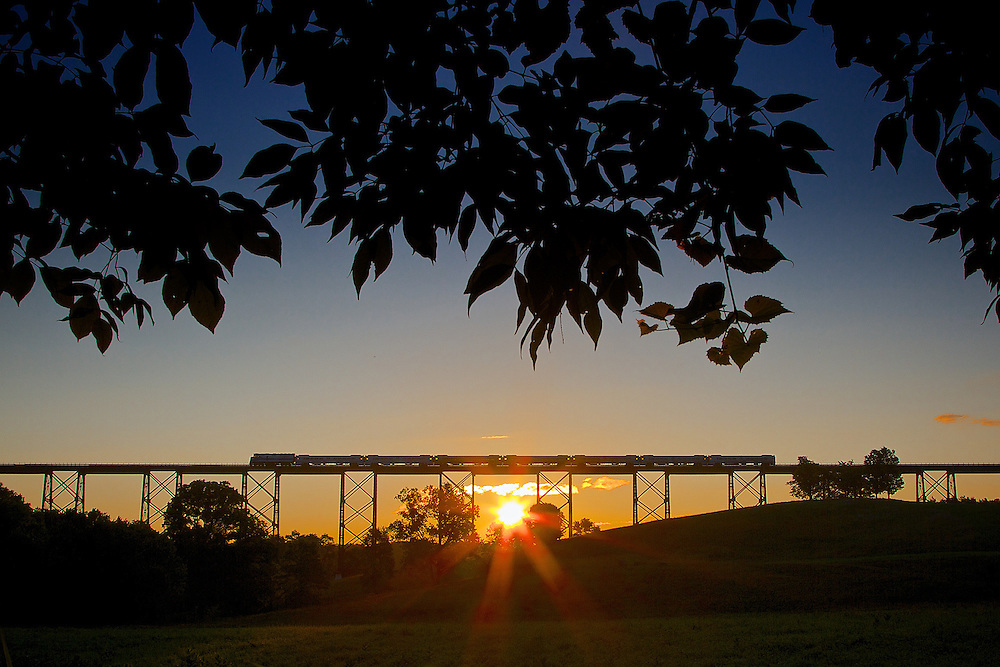 The sun rises over Moodna Viaduct to awaken  the commuters on the start of a sunny day.