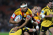 Chiefs' Richard Kahui charges down Hurricanes' Dane Coles. Super Rugby rugby union match, Chiefs v Hurricanes at Waikato Stadium, Hamilton, New Zealand. Saturday 28th April 2012. Photo: Anthony Au-Yeung / photosport.co.nz