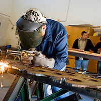 021213       Brian Leddy<br /> Dewayne Ramone practices welding on a 1/2 inch plate of steel at Navajo Technical College Tuesday. The school has over 60 students in the Construction Technology program.