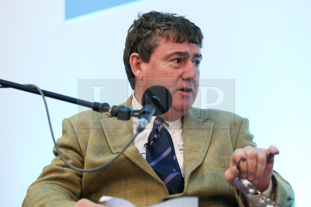 © Licensed to London News Pictures. 11/05/2016. Stoneleigh, UK. Colin Rayner, a Berkshire arable farmer, at a debate about the upcoming EU referendum during the 2016 Pig and Poultry Fair at Stoneleigh, Warwickshire, UK. A recent survey carried out by Farmers Weekly magazine revealed that 58 percent of farmers are in favour whereas only 31 percent said they wanted to remain. The debate was put on by the BBC Radio Four's Farming Today programme and will be broadcast later this month. Photo credit : Ian Hinchliffe/LNP