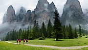 Walk in beautiful Vallunga/Langental through a deeply glaciated U-shaped valley, in Puez-Geisler Nature Park (Italian: Parco naturale Puez Odle; German: Naturpark Puez-Geisler) near Selva di Val Gardena, in the Dolomites, Italy, Europe. The mostly Ladin-speaking town of Sëlva Gherdëine (German: Wolkenstein in Gröden; Italian: Selva di Val Gardena) is in Südtirol/South Tyrol/Alto Adige, in the Dolomiti, part of the Southern Limestone Alps. The Dolomites were declared a natural World Heritage Site (2009) by UNESCO. Panorama stitched from 3 overlapping photos.