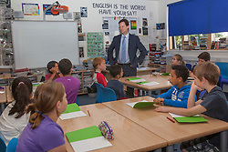 © licensed to London News Pictures. London, UK 23/07/2012. Deputy Prime Minister Nick Clegg today launches one of the first summer schools in London, to see how they are supporting those pupils most at risk from falling behind. Nearly 2,000 new summer schools open their classroom doors today to help some of the most disadvantaged pupils in England in the step up from primary to secondary school. Around 65,000 children are expected to benefit. Photo credit: Tolga Akmen/LNP