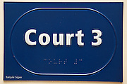 A sign inside a magistrate court for court 3, also in braille.