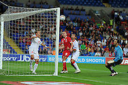 Montenegro keeper Mladen Bozovic (r) is stranded as Elsad Zverotic (l) clears a Steve Morison header off the line.  Euro 2012 Qualifying match, Wales v Montenegro at the Cardiff City Stadium in Cardiff  on Friday 2nd Sept 2011. Pic By  Andrew Orchard, Andrew Orchard sports photography,