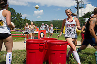 """Beauties and the Beer"" team of Marci, Carly, Jessica and Katrina sink their shots during the ""Beer Pong"" event in the Craft Beer Relay at Gunstock Mountain Resort on Saturday.  (Karen Bobotas/for the Laconia Daily Sun)"