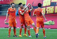 Chen Jie of Guizhou Renhe, second right, celebrates with teammates after scoring a goal against Guangzhou Evergrande during the 28th round of the 2014 Chinese Football Association Super League in Guiyang city, southwest China's Guizhou province, 18 October 2014.<br /> <br /> Guangzhou Evergrande defeated Guizhou Renhe 2-1.