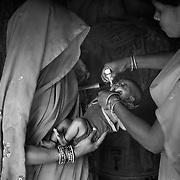 Newborn immunization during the vaccination day on one of the flooded Kosi riverine area near Kusheshwar Astan East, Bihar.
