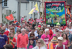© Licensed to London News Pictures. 21/07/2019; Tolpuddle, Dorset, UK. JEREMY CORBYN, leader of the Labour Party leads the parade of trades unions through the village of Tolpuddle, part of the Tolpuddle Martyrs Festival. The Tolpuddle Martyrs Festival for trade unionism, held every year, commemorates the birth of the trade union movement in the 19th century when the Tolpuddle Martyrs were transported to Australia for forming a trade union of agricultural labourers in Dorset. Photo credit: Simon Chapman/LNP.