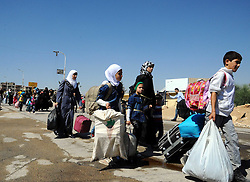 DAMASCUS, Sept. 2, 2016 (Xinhua) -- Syrian civilians carry their belongings to evacuate from the rebel-held town of Muadamiyeh, in rural Damascus, capital of Syria, on Sept. 2, 2016. Nearly 300 civilians, who were originally from the town of Daraya for refuge, were evacuated from Muadamiyeh to government-controlled shelters in southern Damascus. (Xinhua/Ammar) (Credit Image: © Ammar/Xinhua via ZUMA Wire)